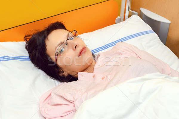 sad middle-aged woman lying in hospital Stock photo © artush