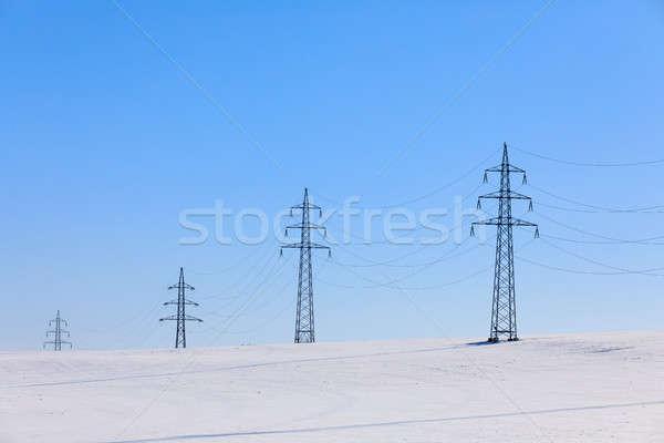 high voltage power lines against a blue sky Stock photo © artush