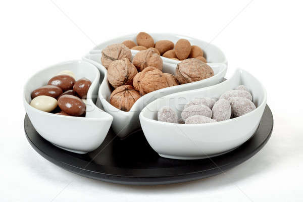 almonds in chocolate and walnuts on white Stock photo © artush