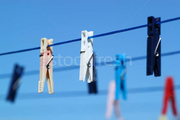 cloth pegs with a under the blue sky  Stock photo © artush