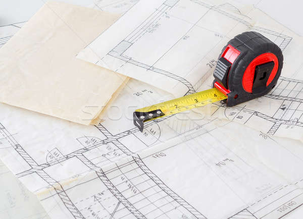 Stock photo: Architectural plans of the old paper and measuring tape