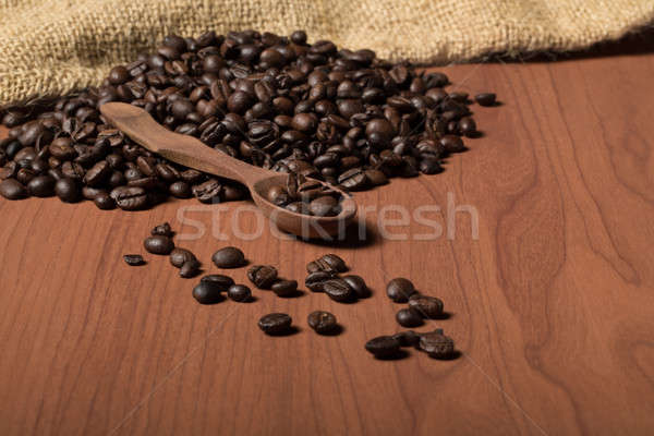 pile of fresh and bio aromatic coffee beans and spoon Stock photo © artush
