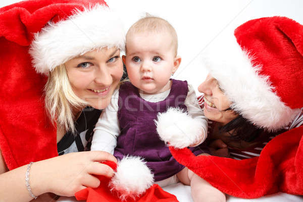 smiling infant baby with two womans with santa hats Stock photo © artush