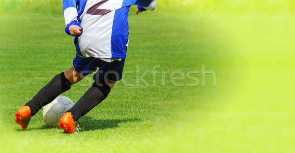 Soccer player legs dribbling in a match  Stock photo © artush