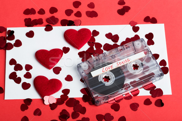 Audio cassette tape on red background with fabric heart Stock photo © artush