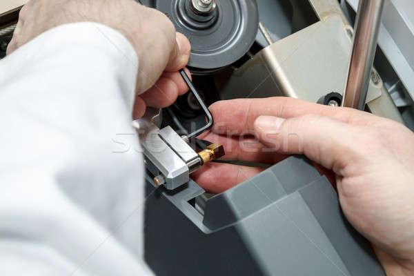 man repairs device Stock photo © artush