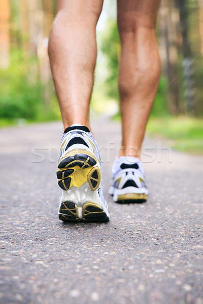 Jogging man. Running shoes and legs of male runner outside on ro Stock photo © ashumskiy