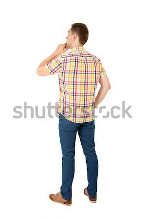 Back view of handsome man in yellow shirt Stock photo © ashumskiy