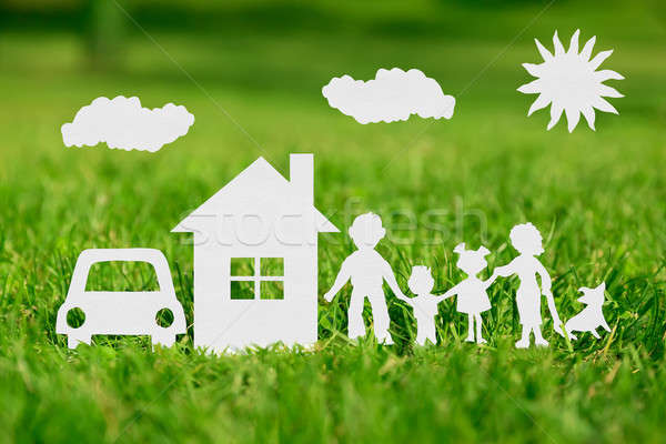 Paper cut of family with house and car on green grass Stock photo © ashumskiy