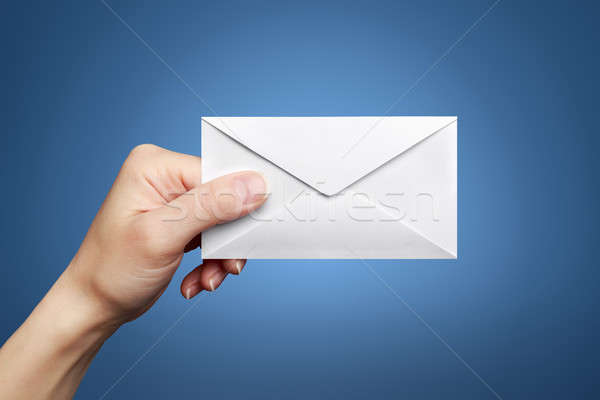 Woman's hand holding closed envelope Stock photo © ashumskiy