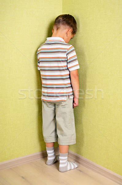 Little child boy wall corner punishment standing  Stock photo © ashumskiy