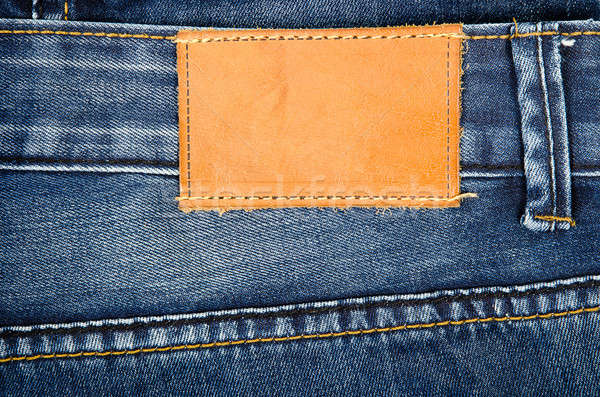 Leather jeans label sewed on jeans Stock photo © ashumskiy