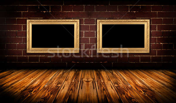 Grungy room with gold frames Stock photo © ashumskiy