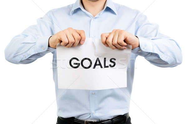 Man tearing a sign which says 'Goals' Stock photo © ashumskiy