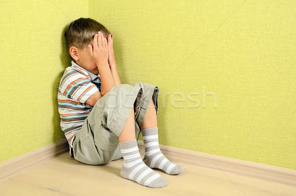 Little child boy wall corner punishment sitting Stock photo © ashumskiy