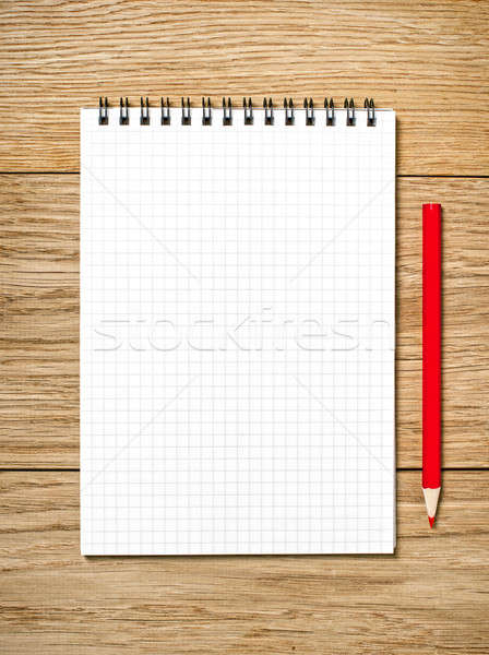 A white note book with lots of room for your text or image and a Stock photo © ashumskiy