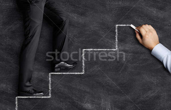 Businessman walking on drawing stairs Stock photo © ashumskiy
