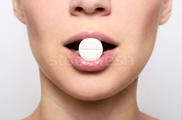 Beauty woman mouth with red lips and medicine pill Stock photo © ashumskiy