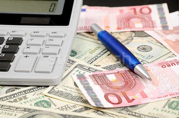 Stylo simulateur euros dollar affaires Photo stock © ashumskiy