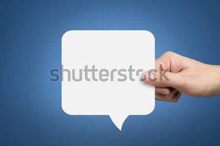 Hand holding an empty speech bubble Stock photo © ashumskiy