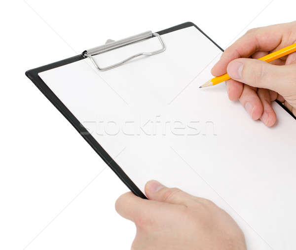 Businessman holding a clipboard and write on it Stock photo © ashumskiy