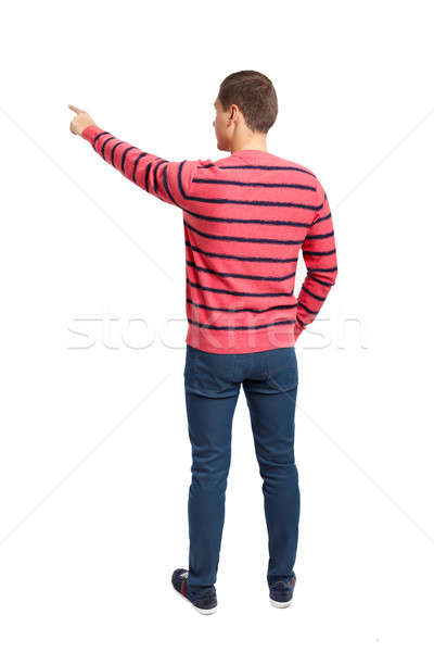 Back view of pointing young men in shirt and jeans Stock photo © ashumskiy