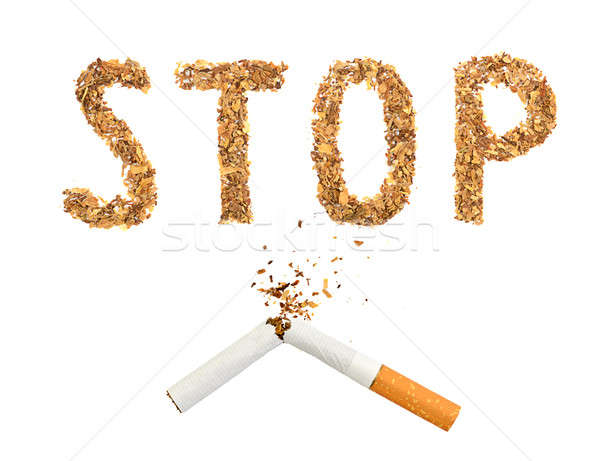 The broken cigaret and word stop made of tobacco Stock photo © ashumskiy