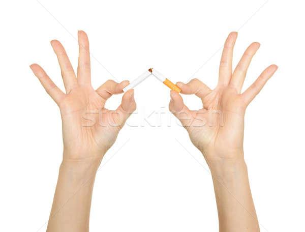 Woman's hand crushing cigarettes  Stock photo © ashumskiy