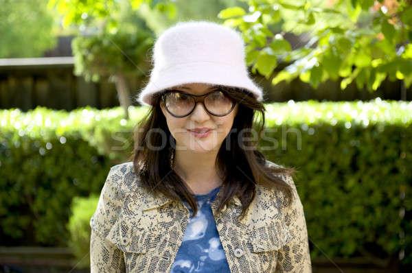 Gülen kız park bohem şık ceket Stok fotoğraf © aspenrock