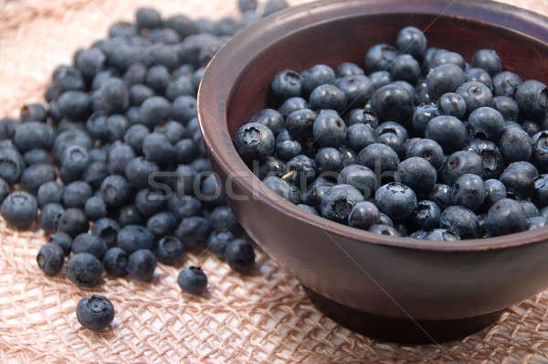 Bosbessen seizoen vruchten Blauw stro kom Stockfoto © aspenrock