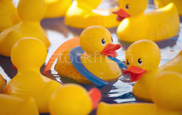 Een ringen rubber gelukkig zwembad Stockfoto © aspenrock