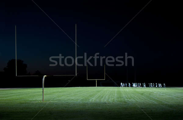 high school foot ball practice on the field Stock photo © aspenrock