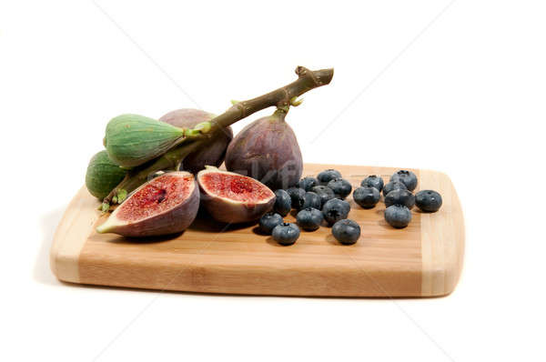 strand of ripe figs and blueberries on a bamboo board Stock photo © aspenrock