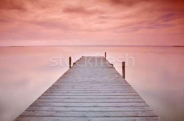 Wooden pier at sunset Stock photo © asturianu