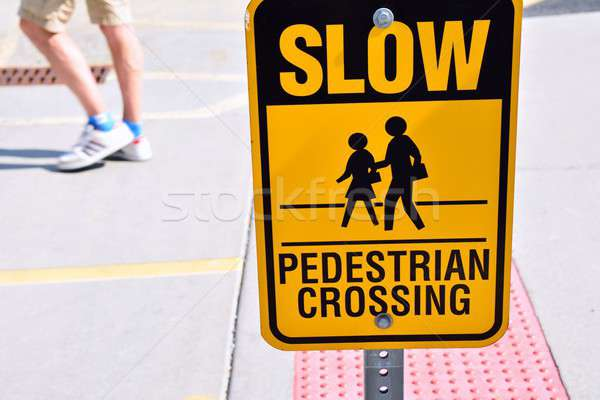 Slow pedestrian crossing sign. Stock photo © asturianu
