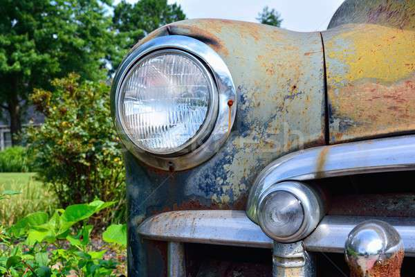 Abandoned rusty old American car. Stock photo © asturianu