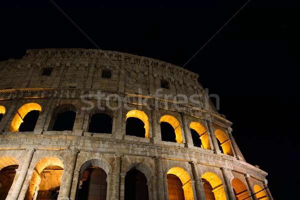 Colosseum megvilágított éjszaka kilátás épület város Stock fotó © asturianu