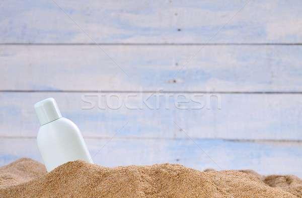 Protector solar jar arena de la playa playa sol salud Foto stock © asturianu