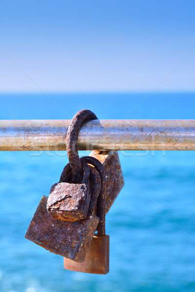 Rusty love locks on railing Stock photo © asturianu