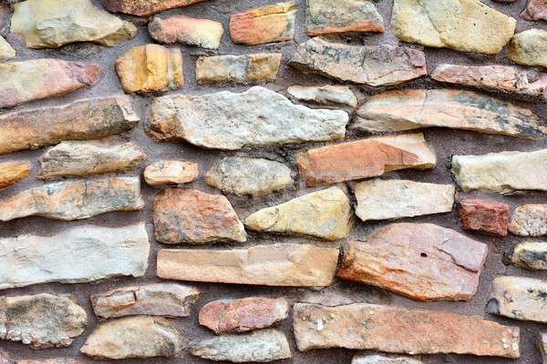 Ancient stone wall to use as background. Stock photo © asturianu