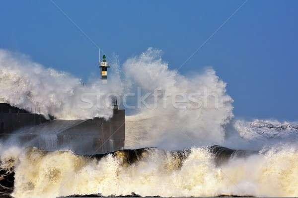 Stock photo: Stormy wave over lighthouse of San Esteban de Pravia.