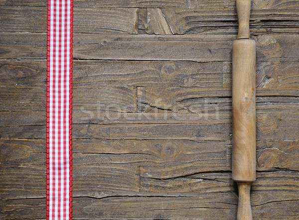 Rolling pin and red and white ribbon Stock photo © asturianu