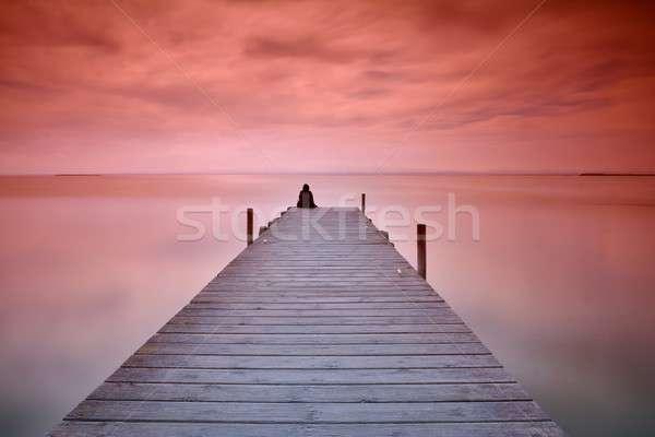 Magányos személy ül móló felismerhetetlen személy perem Stock fotó © asturianu