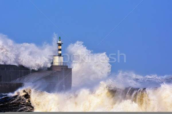 Stormy wave over lighthouse of San Esteban de Pravia.  Stock photo © asturianu