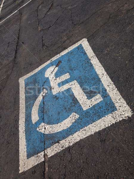 Disabled parking sign painted on asphalt. Stock photo © asturianu