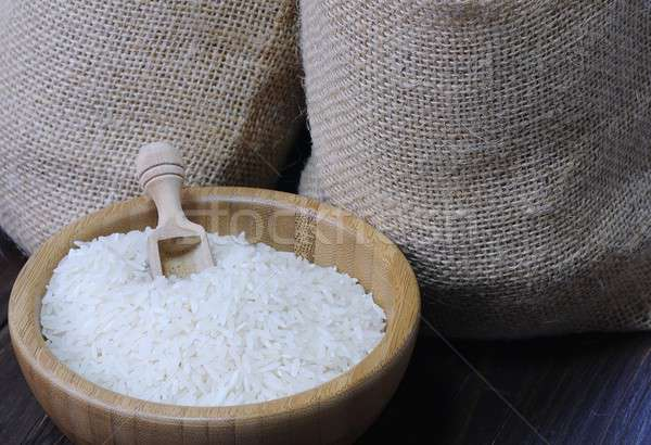 White rice in bowl against of two textile bags Stock photo © asturianu