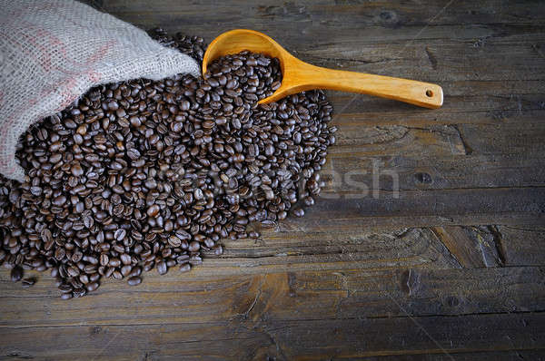 Close-up of coffee beans in textile bag with spoon Stock photo © asturianu