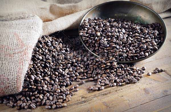 Heap of roasted coffee beans on wooden table Stock photo © asturianu