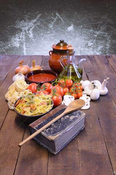 Livre de cuisine table de cuisine ingrédients pétrolières tomate cuisson Photo stock © asturianu