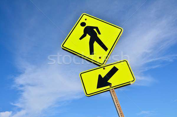 Pedestrian sign, Yellow man walking. Stock photo © asturianu
